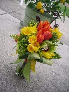 Yellow roses, orange tulips, fragrant tuberosas and greens.