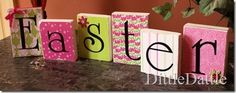 blocks with scrapbook paper, modge podge to attach, circuit letters and ribbon around the edges.