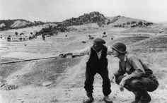 Robert Capa in Italia. A Sicilian peasant shows an American officer how the Germans had fled. Near Troina, 4 – 5 August 1943. #RobertCapa #photography #history #war