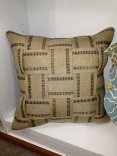 Webbing pillow.  For sale in our boutique!