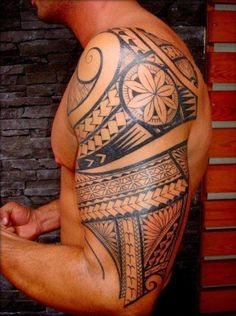 Polynesian Tattoo Designs on Arm, Men Shoulder with Polynesian Tattoos, Shoulder Arm with Polynesians Tattoo #tattoospolynesiansleeve #tattoosformenonshoulder #polynesiantattoosshoulder