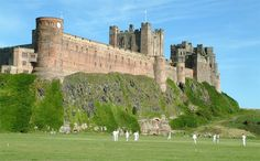 Bamburgh CC in Northumberland, England. Perhaps one of the most iconic cricket pitches in the UK Alnwick Castle, Castle Ruins, Medieval Castle, Castle Rock, Great Places, Beautiful Places, Cricket England, Castle Pictures, Cycle Ride