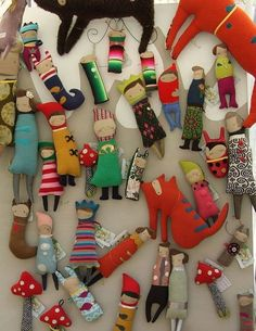 handmade dolls and toys...nice technique, looks fun! I like the lime green crowned doll in the middle.