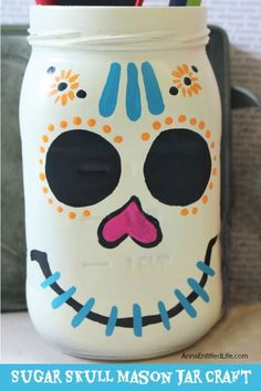 Sugar Skull Mason Jar Craft. This easy to make sugar skull is fashioned from an old Mason jar.  You can store kitchen utensils, candy (keep the lid!), etc in these jars for Halloween or to celebrate the Day of the Dead. Using old glass jars is a great way to get crafty at home and make your own cute decor at the same time.
