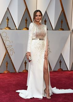 Chrissy Teigen looks stunning in a white Zuhair Murad Couture gown.