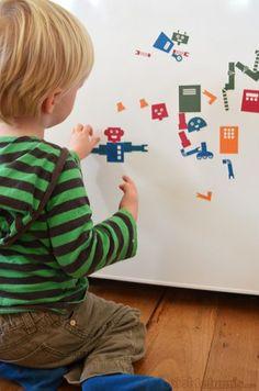 Robot-onderdelen (gratis) downloaden via de link / bron, uitprinten en de achterkant verven met magneetverf. Kids kunnen eindeloos eigen robots combineren op een magneetbord.