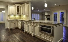 2014 Contest 2nd place winner. Microwave base cabinet with deco legs and glass doors. Signature Pearl finish