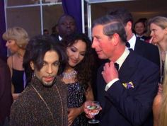 Prince and Prince Charles - Not exactly the most comfortable looking companions...