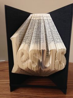 Religious Christian Jesus Faith Unique, one of a kind hand folded gifts for any occasion. These folded books are great home decor and can be customized for hand made wedding gifts, birthday presents, unique anniversary gifts and more. Folded book art is unique gift idea. Perfect for Mother's Day gifts, Father's Day Gifts, Wedding Gifts, Anniversary Gifts, Valentine's Day Gifts, Easter presents, Birthday presents. Customized folded books can be ordered at www.creativebookart.com.