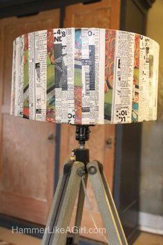 Mod Podge newspaper/magazine strips to drum shade.   How to decorate a lampshade with vintage graphics