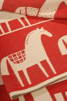 Swedish Horse Cotton Blanket    ---     A chenille blanket is good to have around you whether in front of the TV our outside on a picnic. It is smooth, soft as velvet, and stays in shape even after it has been repeatedly washed. For outdoor living cotton is an excellent alternative to our wool products.