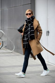 Stan Smith sneakers with a blanket scarf and camel coat