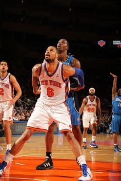 Tyson Chandler (New York Knicks) boxes out Dwight Howard (Orlando Magic) #NYCPride