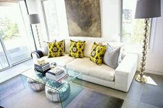 Love the idea of storing Moroccan poufs under an acrylic coffee table.   www.moroccansunset.co.nz