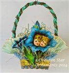 Blue Trumpet Flowers with Children's Faces on Pastel Blue Crepe Paper Basket. Handmade OOAK by Dresden Star http://www.hometraditions.com/category_s/1909.htm