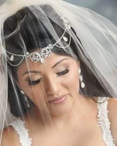 a6b84bb09874 Bridal beauty Crystal dazzling in her custom bridal headpiece and jewelry  by Bridal Styles Boutique.