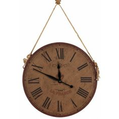 Antiqued round wall clock with a burlap hanger and Roman numerals. Product: Clock Construction Material: Wood and burlap Color: Natural Accommodates: Batteries - not included Dimensions: Diameter Tick Tock Clock, Cottage Style Furniture, Black Spades, Industrial Chic Style, Burlap Wall, Tabletop Clocks, Grandfather Clock, Nebraska Furniture Mart, Vintage Country