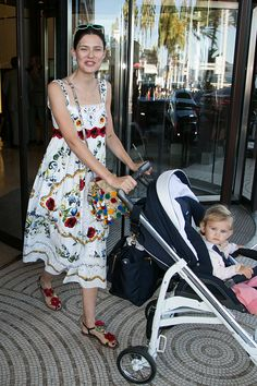 Model Bianca Balti and daughter Mia McRae leave the 'Grand Hyatt Martinez Hotel' during the annual 69th Cannes Film Festival on May 19 2016 in Cannes...