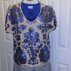 Sequined Tracy Reese top. Medium Great sequined top in a gorgeous blue design on a matte gold background. Back of shirt is a plain solid blue. Like new condition. A little wrinkled from storage. Medium, but runs a little big. Chest measures 20 inches across laying flat. About 26 inches long from the shoulder. 100% polyester. Front is lined. Tracy Reese Tops