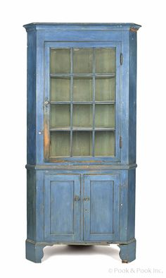 """Realized Price: $3792  Pennsylvania two-part painted pine corner cupboard, ca. 1820, retaining an old blue surface, 90"""" h., 42 1/2"""" w."""