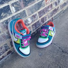 Lightly worn rainbow nike sneakers Only worn a couple times !!!! So cool just not my style!!!!  Very vibrant! Nike Shoes