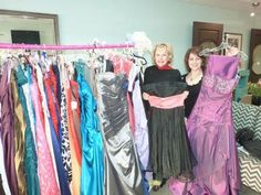 Claire Lowe / Fabiana Edward Salon owner Fabiana Hackett and receptionist Suzette Hay show off the prom dresses they collected for a dress drive this weekend to benefit the Maliha Chowdhury scholarship fund.