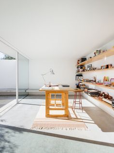Scandinavian workspace with concrete floor and lots of sunlight. House in Preguiçosas by João Branco + Paula del Río.