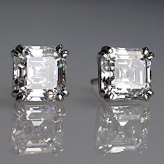 Matching asscher cut diamond earrings in platinum.
