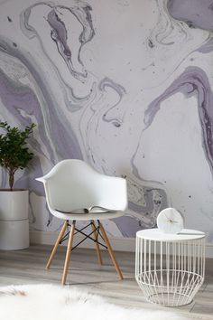 Inject some sophisticated, artistic flair into your home with this marbleised wallpaper mural. Stylish and modern, it's the perfect design to complement a cosy reading nook or a spare room. (Photo: Murals Wallpaper). Get more wall decorating ideas at housebeautiful.co.uk