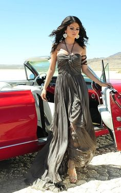 Selena Gomez, A Year Without Rain. I've always loved this dress. One of my favorite of her songs as well.