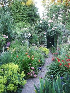 English garden (love it!but I'd of put in a little wide spot with a bench so you'd have a choice between moving and stillness. Diy Garden, Garden Cottage, Dream Garden, Garden Landscaping, Cacti Garden, Garden Path, Summer Garden, Back Gardens, Outdoor Gardens