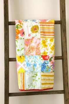 Craftyblossom: vintage sheet patchwork quilt with polka dot binding