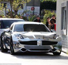 Justin Bieber chromed out Fisker Karma. Cool car but a hazard in L.A.'s sunlight.