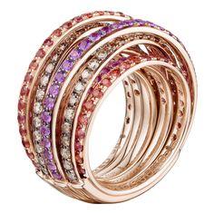 Named after the eldest daughter of de GRISOGONO's founder, a joyful spiral of soft, rich gold bands.