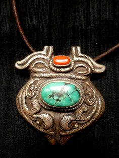 Tibetan Pendant. Beautiful Carvings on both sides. Silver, Turquoise and Coral. Ethnic Jewelry