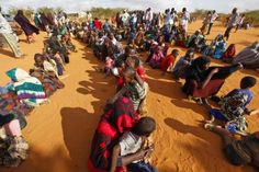 Refugees who fled the famine in Somalia wait in a reception area in 2011 at a camp in Dadaab, Kenya. Kenya's Catholic bishops urged their government to reverse its decision to repatriate all refugees in the country and close all the refugee camps. (CNS photo/Dai Kurokawa, EPA)