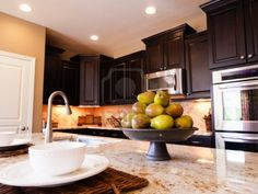 dark cabinets with stainless steel appliances