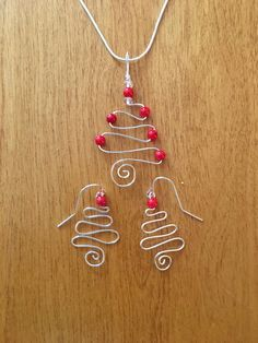Red Coral Christmas Tree Pendant and Earrings w/ Silver Plated Wire and Chain. Red Coral properties are Metabolism, Balance & Harmony