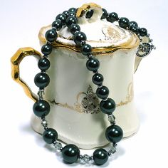 Rich and elegant shell pearls in the most coveted black Tahitian pearl shade.  I have used four sizes of Tahitian shell pearls.  Towards the front of the necklace I added in Swarovski Austrian crystal