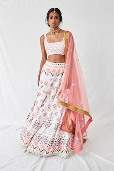 Coral pink and green floral print cotton lehenga with box pleats and a mirror and cut-dana embroidered waist with pockets paired with a floral crop top with mirror and cut-dana highlights and a coral dupatta with a bright green banarsi-silk border and thr Indian Gowns, Indian Attire, Indian Ethnic Wear, Indian Sarees, Floral Lehenga, Cotton Lehenga, Coral Saree, Bridal Lehenga, Lehenga Designs