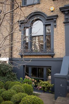 Ahern's Dark and Dramatic East London Home i like the gray trim with this brick color. Abigail Ahern's Dark and Dramatic East London Home — House Tour Exterior Paint Colors, Exterior House Colors, Paint Colors For Home, Black Front Doors, Front Door Colors, Renovation Facade, Yellow Brick Houses, Her Wallpaper, Deco Restaurant