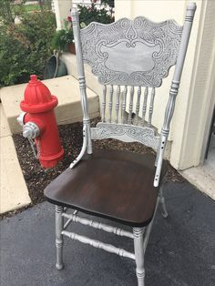 Stunning combo of General Finishes Seagull Grey Milk Paint and Pitch Black Glaze Effects on this 80's oak farmhouse style chair! Beautiful stained seat in Kona stain gives a warm complimentary color and pulls it together! Visit By Michelle for more projects!