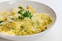 Baked Spaghetti Squash with Garlic and Butter - spaghetti squash, butter, garlic cloves, fresh parsley, salt, shredded Parmesan cheese