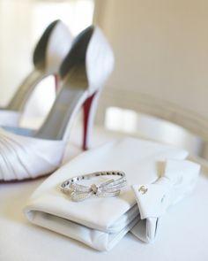 leather Chanel clutch. Chanel bow bracelet. white Christian Louboutin pumps (city hall wedding ideas)