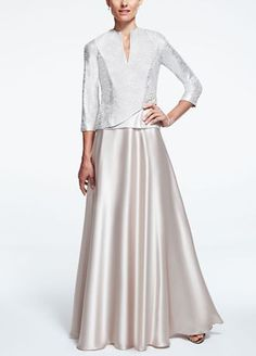 $199 - A classic and demure look that is ideal for any mother of the bride or groom!  Features 3/4 sleeve wrap mock jacket with dazzling broach.  Long charmeuse skirt gives this dress a whimsical feel.  Fully lined. Back zip. Imported polyester. Dry clean only.