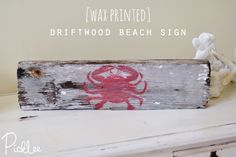 DIY Driftwood Sign with Red Crab printed on it with wax paper technique.