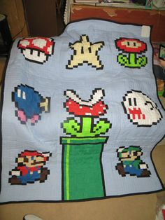 A pixel by pixel quilt from Super Mario Bros. on the NES.