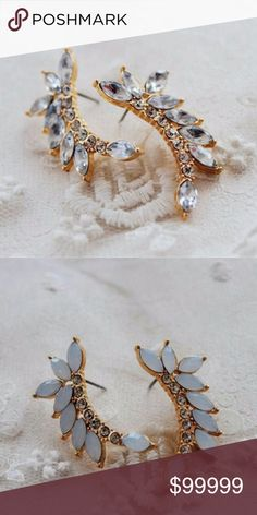 ✨COMING SOON✨White/Silver Stone Gold Ear Cuffs These amazing ear cuffs come in two colors, take your pick! Clear (first photo) or white (second photo) stones ✨ Jewelry Earrings