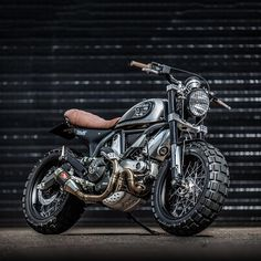 Fat tires: Yes or no? This is the latest build from the wide boys at @downandoutcaferacers in England, a @scramblerducati with custom yokes and 180-section TKC80 rubber.  Hit the link in our profile for an exclusive report — and a stunning set of hi-res images from @motorcycle_photo_guy.  #ducati #scrambler #scramblerducati #ducatigram #bikeexif