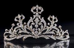 A diamond tiara designed as a tapered openwork panel of old European-cut diamond scrolls, set in platinum and gold. (Bonhams)